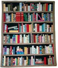A book quilt :D This actually looks fairly easy to sew! You could embroider the names of books on the bindings.... The Scarlet Pimpernel, Pride and Prejudice, Anne of Green Gables, Nancy Drew, Tale of Two Cities...I would LOVE something like this!! Perfect for my book reading chair :)