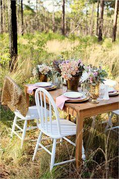 Rustic floral arrangement in gold bucket for a vintage feel with a touch of glam--- unveiled 2013 table