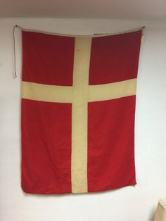Very Rare!!! Not another one on the internet and we checked!!! World War II Danish flag. It is in remarkable condition considering its age. A few minor stains and holes, but it wouldnt be vintage without it. The fabric appears to be a wool and or cotton blend. It has a hook an eye on one side and a draw string style rope on the other. This will go great in any house and its a nice compliment to your mid century furniture.  Approx 55 x 40 inches.  Free shipping to Lower 48
