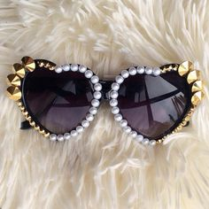 Gorgeous heart sunglasses w/ gold Swarovski rhinestones and pearls.400% UV Protection*each adornment is carefully hand affixed. Please allow 2 weeks for processing as each item is handmade w/ love just for you!*