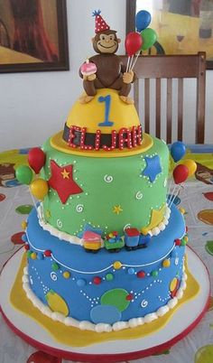 3 tier first birthday cake with Monkey on top.JPG