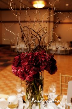 Different color flowers with my twisted twigs in my large burgundy vases. 2 of these would be perfect for my mantle.