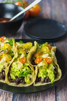 This easy to prepare Vegan Black Bean Tacos recipe is perfect lunch or weeknight dish for busy parents. Seasoned black beans with guacamole, lettuce, and tomatoes are so healthy and full of flavors. Veggie Recipes, Mexican Food Recipes, Whole Food Recipes, Cooking Recipes, Healthy Recipes, Vegan Bean Recipes, Vegetarian Recipes For Beginners, Gluten Free Vegetarian Recipes, Mexican Dishes