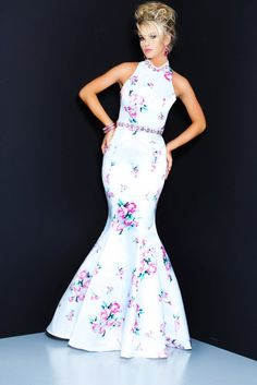 74050c933d6 71020 style has a unique cutout back and floral print. This satin dress has  a trumpet fit that is always flattering!