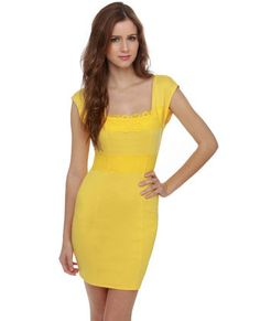 """Paradise Found Yellow Lace Dress! A stretchy jersey knit is embellished with bands of lace around waist and below a square neckline. Scoop back has invisible zipper. Unlined and slightly sheer. Model is wearing a size small. Small measures 31"""" long. 4"""" sleeve (from neckline). 22"""" waist (relaxed). 28"""" bust (relaxed). 86% Polyester, 12% Rayon, 2% Spandex. Hand Wash Cold. Made with Love in the U.S.A."""