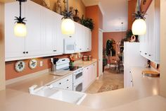 Light and bright kitchen offers double oven, Bosch dishwasher, newer microwave and under counter lighting.