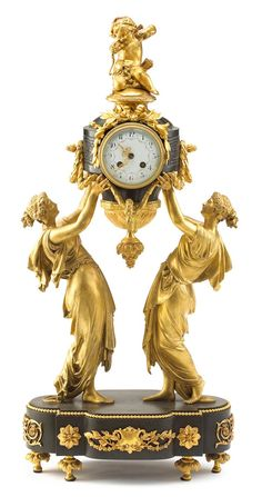 Louis XVI style gilt and patinated bronze mantle clock,  19th century, in the style of charpentier, retailed by Black, Starr, and Frost.  PROVENANCE:  The collection of Dr. Alex Titomirov, Great Falls, Va. #FreemansAuction