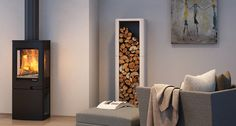 Cauto vednisje - Hvitmalt betong vedhylle i stuemiljø fra Nordpeis.   Veil. pris inkl. mva kr 3 150,-