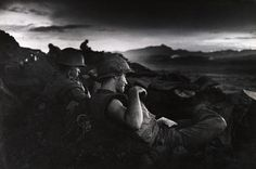 """Dinner finished . . . weapons handy . . . too late to reread the last letter from home, the Con Thien Marines started easing into their trenches, ready for another night among imaginations and memories, while waiting for reality from below. [September/October 1967.]"" War Without Heroes, p. 139. (Photo by David Douglas Duncan)"