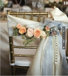 Love this! - Bride's chair decorated with garden roses and cascading pearls