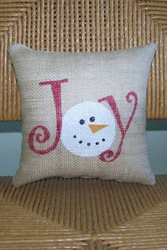 This fun little snowman Joy accent pillow will make a great addition to any room of your house. Made from burlap fabric and stenciled in red, white and black fabric paint with a felt nose. The backing is a solid muslin fabric. Poly fiber fill stuffing and ready to display. *Please note this pillow comes already stuffed and ready for display!  **If you dont see the quantity you need please contact me and I will check the current inventory for you.  *Burlap is made from a plant which may…
