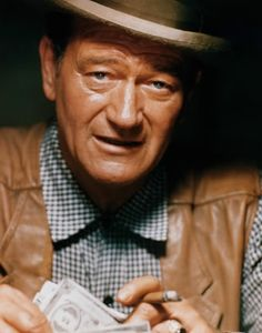 John Wayne starred in the 1961 western 'The Comancheros', and directed the remainder of the film when director Michael Curtiz took ill. (© CinemaPhoto/CORBIS)