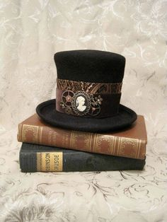0481bee6b5a felt top hat with cameo on old books