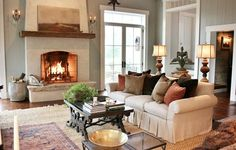 fireplace, flanking french doors, furniture layout Finishing an Old Attached Barn in New Hampshire