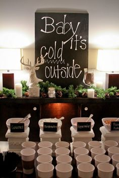 Hot Chocolate Bar - Have toppings - crushed peppermint, sugar sticks, mini marshmallows, whipped cream, etc. Also the sign is a cute saying !!!!