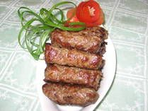 It has been said the casing-less sausages known as cevapcici or cevaps found their way into Eastern Europe via the Ottoman Empire, which picked them up from Arabic cultures around Persia.  Today, there are different versions of cevapcici throughout Croatia, Serbia, Bosnia-Herzegovina and Macedonia. Some use pork and lamb, others use pork, lamb and beef, and yet others omit the pork entirely.  Originally, they were skewered and grilled over an open fire.