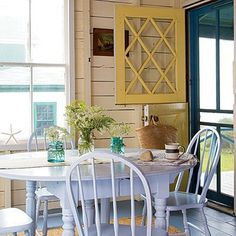 My grandmother's backdoor was a dutch door and I would love to have one some day. I love this one because of the window detail and the bright colors...actually, I love this entire room