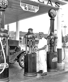 View showing a Pan Gas Service Station where an attendant is seen filling an oil can and posing for the camera. Old Gas Pumps, Vintage Gas Pumps, Vintage Photographs, Vintage Photos, Pompe A Essence, Gas Service, Old Garage, Old Gas Stations, Old Country Stores