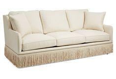 This inviting sofa adds to the serenity of the space, and the tassel trim is a sophisticated touch.