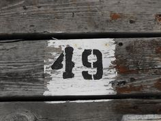 [This painted sign, indicating dock number 49, is located on a wooden dock at the the north end of Dows Lake.]