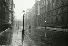Rain: A lone person walks along a deserted street in central London on a drizzly day - which doesn't seen too different from the modern day