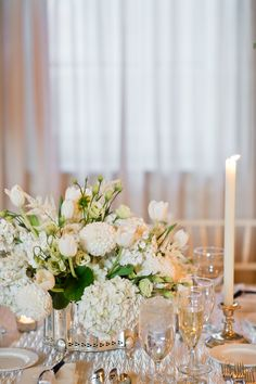 Silver cachepot with all white flowers along rectangular tables at the Merion Cricket Club. Nancy Saam Flowers Amanda Young Photography