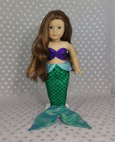 Turn your doll into Disney Princess Ariel with this beautifulboutfit made with performance and organza fabrics, bodice lined and Velcro closure in the back. This listing is for the outfit only. The do