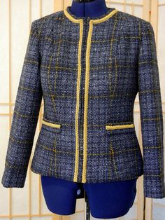 chanel style jacket: vogue 7975 pattern.  Impressed by the absolutely perfect pattern matching, check out them lines!