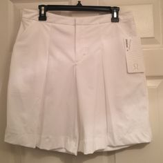 Lululemon Long Story Short 10 White NWT Lululemon Long Story Short 10 White NWT these adorable shorts have reflective pockets to help you be seen and lowlight. Pockets, straight fit, medium rise. Size 10. White color. New with tags. No trades please. lululemon athletica Shorts