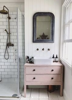 farmhouse bathroom with furniture vanity, dresser turned vanity with vessel sink and farmhouse mirror, walk in shower with white subway tile, pink vanity in rustic bathroom design Bathroom Trends, Diy Bathroom Decor, Bathroom Furniture, Bathroom Interior, Modern Bathroom, Bathroom Vanities, Bathroom Ideas, Bathroom Remodeling, White Bathroom