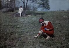 Picking flowers in a red dress c. 1920s