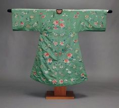 Woman's domestic robe (pao)      Chinese (Manchu), Qing dynasty, 1880s       China Dimensions     142.5 x 176.5 cm (56 1/8 x 69 1/2 in.) Medium or Technique     Silk satin embroidered with silk