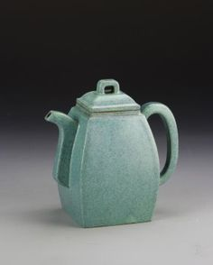 China, Yixing Zisha Teapot, in a four sided form, with square base, in a blue hue, with speckled glaze, and smooth surface, mark on base. Height 5 1/2 in.