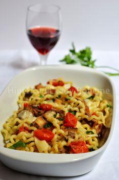 ITALIAN FOOD - FUSILLI CON MELANZANE E POMODORINI - (Fusilli pasta with eggplant and cherry tomatoes).