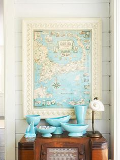 A vintage map gives this entryway cottage style. Tour the rest of this modern beach home: http://www.bhg.com/decorating/decorating-style/modern/beach-house-decorating/#page=7