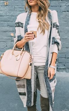 We are dreaming of this Blue Long Stripe Cardigan with boots and skinnies and with our favorite latte in hand! This cool weather piece begs to be worn. These piece features a very soft knit and vertical grey and navy stripes. Looks great paired with our Pink Wide Knit Scarf. Model is wearing a Small.