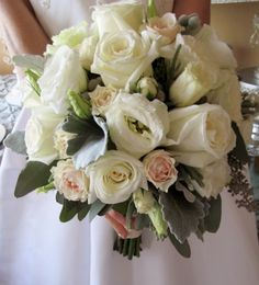 White and blush toned roses accented with silvery grey foliage.