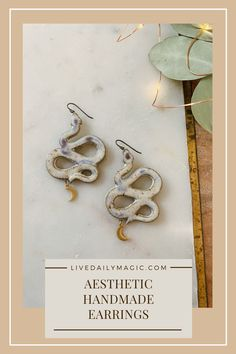 Complete your aesthetic with these handmade snake earrings, paired with celestial crescent moon charms. Always unique and one of a kind - get yours on the website!