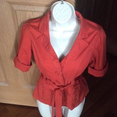 Forever 3- button belted jacket Lightweight jacket.  Cute with jeans.  Buttoned cuffed sleeves.  Burnt orange in color. Forever 21 Jackets & Coats