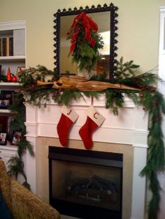 Mantle decorated with fresh garland, cones, balsam, red twig dogwood. A swag to dress up the mirror and kids stockings waiting for santa.