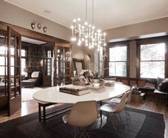 Beige dining room with an eclectic mix of furnishings & decor.