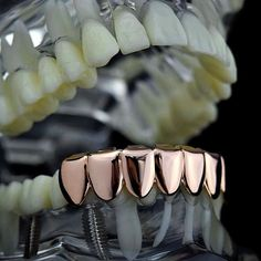 How Would I Mold These Grillz To My Teeth At Home? The white silicone mold (included) is dropped in a hot mug of water until the mold turns clear. Once clear, it is placed inside the grillz as you wil