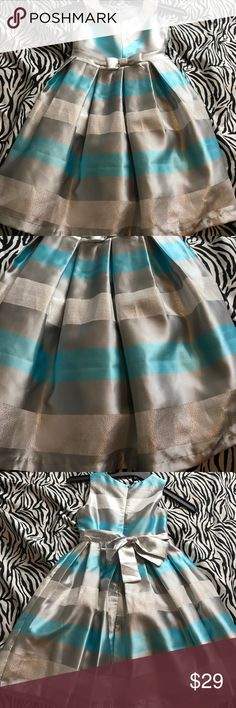 Girl Bonnie Jean dress size 7 This dress is silver and teal and is incredibly gorgeous. My daughter wore it only one time for her birthday party. Bonnie Jean Dresses Formal