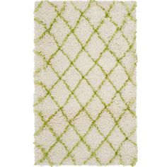 Add a touch of texture to your living room or den with this artfully crafted shag rug, showcasing a trellis motif in ivory and green.  ...