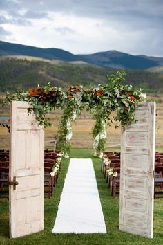 rustic old door and greenery wedding entrance #rusticdecor #rusticwedding #countrywedding http://www.deerpearlflowers.com/wedding-reception-entrance-ideas/