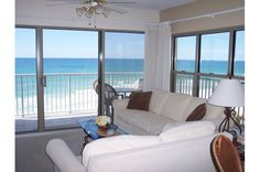 This living room, in a corner unit at Emerald Towers West. offers gorgeous views of the beach and Gulf.