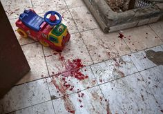 20161118 - The bloodstained floor of a kindergarten, following reported shelling in the rebel-held area of Harasta, on the northeastern outskirts of the capital Damascus. At least four children were killed and 19 people injured in the government strike in Harasta, according to the Syrian Observatory for Human Rights. #  Sameer Al-Doumy / AFP / Getty