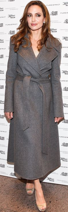 Angelina Jolie looking effortlessly polished in a gray belted coat