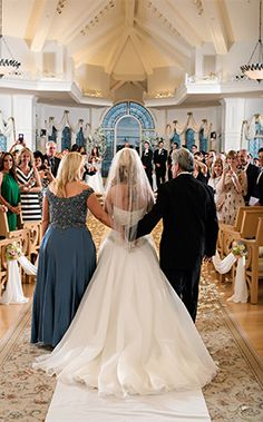 Precious moment of a bride and her parents at Disney's Wedding Pavilion