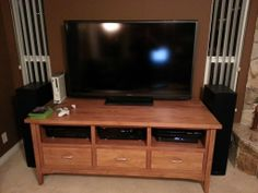 Do it yourself: Altered an old, impractical TV cabinet to accommodate for some updated technology.